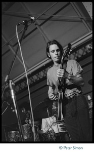 Thumbnail of Bob Weir (Grateful Dead), performing on guitar at MIT during the             student strike against the war in Vietnam and killings at Kent State