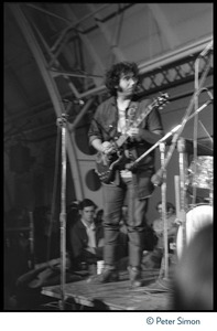 Thumbnail of Jerry Garcia (Grateful Dead), performing on guitar in concert at MIT during the             student strike against the war in Vietnam and killings at Kent State