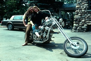 Thumbnail of Michael Rapunzel with motorcycle and Joanne Santos