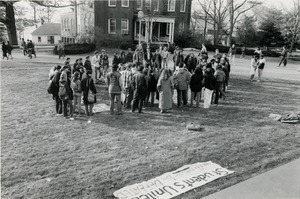 Thumbnail of Rally near Whitmore Hall, UMass Amherst, with banners reading 'CIA out of UMass' and 'Students united will never be defeated'