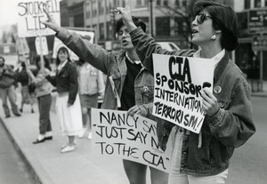 Thumbnail of Anti-CIA protesters in Northampton with placards reading 'CIA sponsors             international terrorism;' 'Nancy just say no to the CIA,' and 'Stockwell lies'