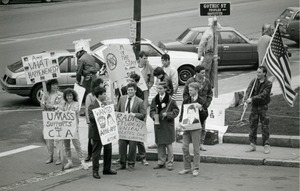 Thumbnail of Right wing protesters carrying and American flag, Ronald Reagan poster, and placards opposing Amy Carter and Abbie Hoffman