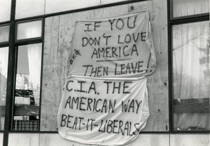 Thumbnail of Banners hanging on building (possibly Beta Kappa Phi frat) at UMass Amherst reading 'If you don't             love American then leave!' and 'CIA the American way, Beat it liberals'