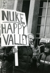 Thumbnail of Right wing protester at UMass Amherst with placard reading 'Nuke Happy Valley'