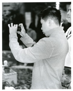 Thumbnail of Asian man shooting flower show