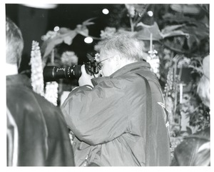 Thumbnail of Big man/big camera at flower show