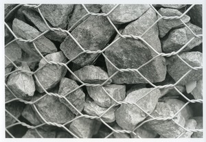 Thumbnail of Chain link holding rocks