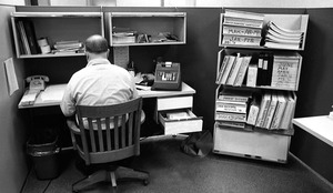 Thumbnail of Office worker at his desk