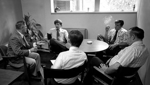 Thumbnail of Office workers in a meeting