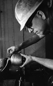 Thumbnail of Rodney Hunt worker with an oil can