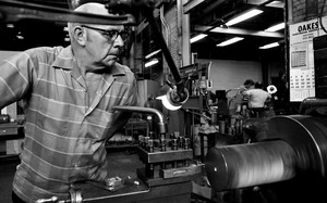 Thumbnail of Worker at a grinding machine