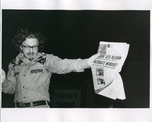 Thumbnail of Art Kunkin holding up newspaper