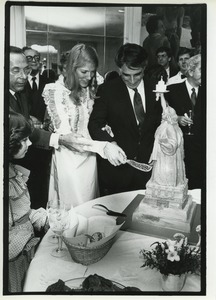 Thumbnail of Andrew Stein and Lynn Forester cutting wedding cake