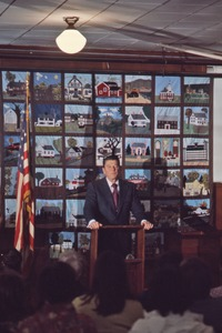 Thumbnail of Ronald Reagan in front of patchwork quilt