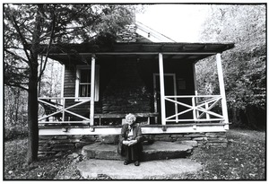 Thumbnail of Schoolteacher outside one-room schoolhouse in Ulster County