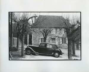 Thumbnail of Car parked in front of stone house in France