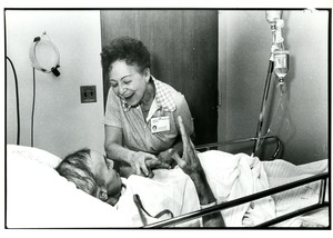 Thumbnail of Hospital volunteer with patient