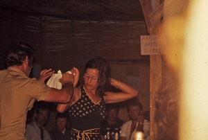 Thumbnail of Dancing man and woman at a discotheque