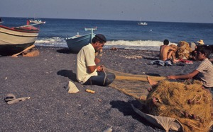 Thumbnail of Fishermen mending their nets