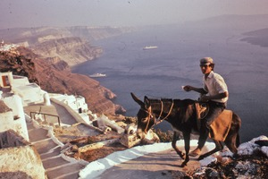 Thumbnail of Man riding mule