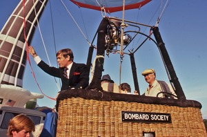 Thumbnail of Balloonist Buddy Bombard waves from hot-air balloon