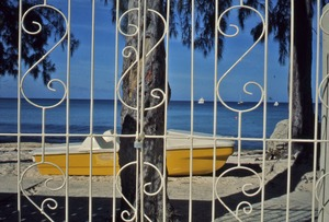 Thumbnail of Yellow boat behind fence