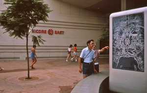 Thumbnail of Couple checking a kiosk