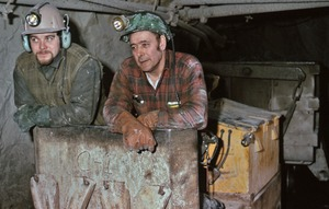 Thumbnail of Gold miners in rail conveyor