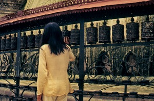 Thumbnail of Man working with prayer wheels