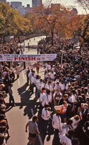 Thumbnail of New York City marathon runners at the finish line