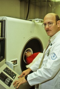 Thumbnail of CAT scanner technician and patient
