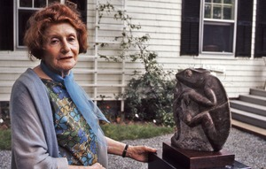 Thumbnail of Grete Schuller with her sculpture of two lizards