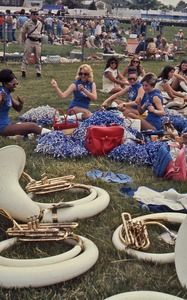 Thumbnail of Young cheerleaders with instruments in foreground