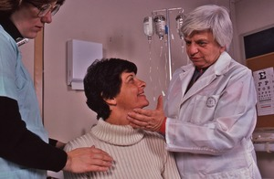 Thumbnail of Delores Krieger with hand on patient's throat