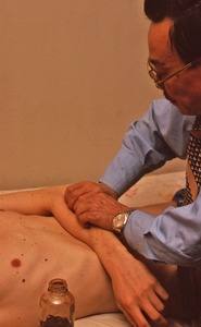 Thumbnail of Dr. Garland Song treating a patient