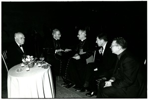 Thumbnail of Men in conversation