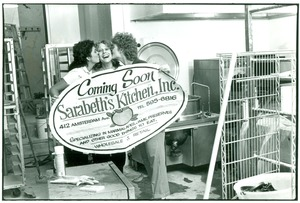 Thumbnail of Sarabeth with her new sign for Sarabeth's Kitchen