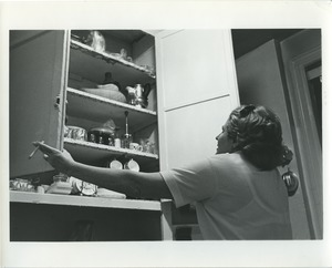 Thumbnail of Miriam examines the cupboards