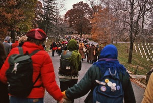 Thumbnail of Demonstrators join hands while marching toward the Pentagon