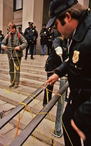 Thumbnail of Police cut threads woven by demonstrators