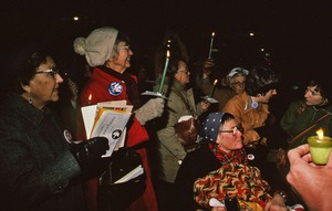 Thumbnail of Anti-war demonstrators holding candles