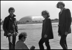 Thumbnail of The  Velvet Underground: (l.-r.) Lou Reed, Doug Yule, Maureen Tucker, and Sterling Morrison, posing by the Charles River