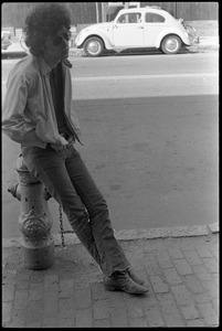 Thumbnail of The  Velvet Underground: Doug Yule leaning against a fire hydrant
