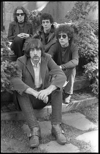 Thumbnail of The  Velvet Underground: (l.-r.) Maureen Tucker, Lou Reed, Doug Yule, and Sterling Morrison (front) posing in a circle garden