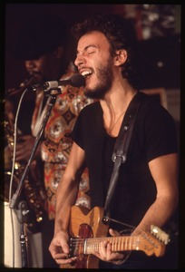 Thumbnail of Bruce Springsteen with Clarence Clemons in the background, performing at Joe's Place