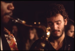 Thumbnail of Bruce Springsteen with Clarence Clemons in the foreground, performing at Joe's Place