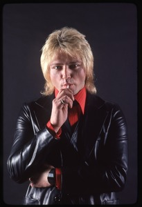 Thumbnail of The Cars, photo shoot for Candy-O: Benjamin Orr sucking on a lollipop