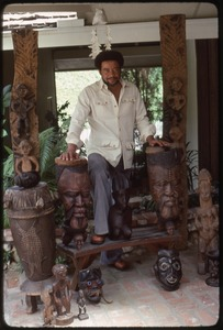 Thumbnail of Bill Withers: Withers surrounded by African sculpture