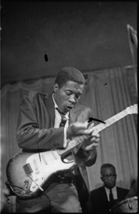 Thumbnail of Buddy Guy and his Bluesband at Club 47: Buddy Guy with guitar and drummer Fred Below in background