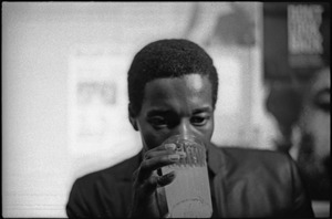 Thumbnail of Buddy Guy and his Bluesband at Club 47: Buddy Guy backstage drinking from glass